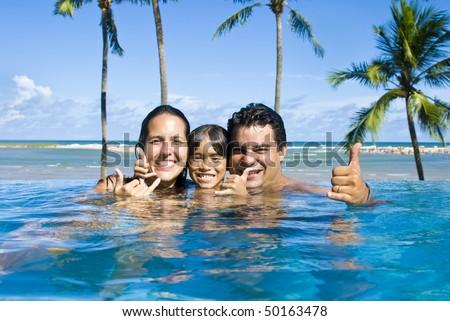 Happy Family having fun in the pool . - stock photo