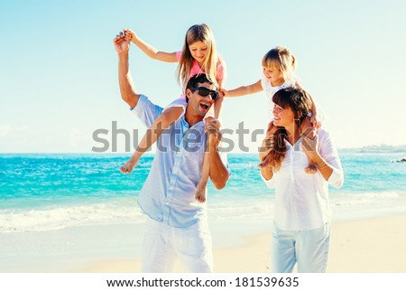 Happy Family Having Fun on Tropical Beach - stock photo