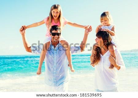 Happy Family Having Fun on Tropical Beach - stock photo