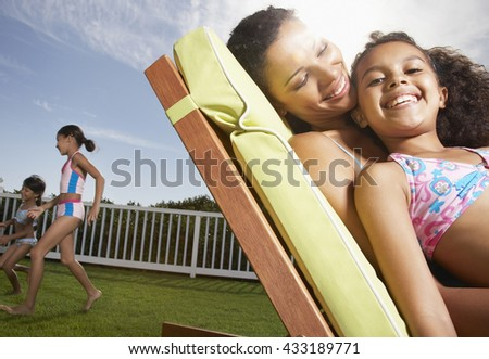 Happy family having fun outdoor - stock photo