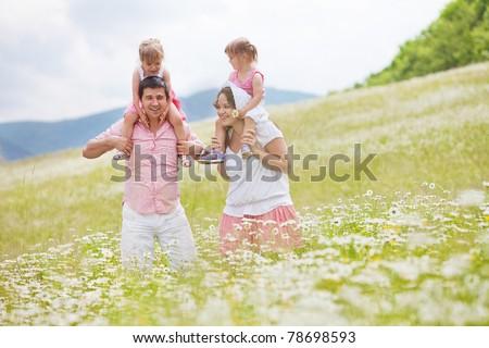happy family having fun outdoors - stock photo