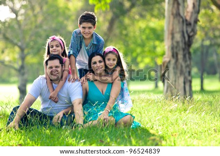 Happy family having fun outdoors in spring green park - stock photo