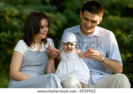 happy family having fun outdoors on a sunny day - stock photo