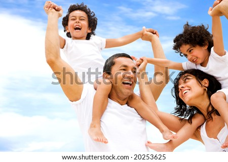 happy family having fun outdoors while on vacation - stock photo