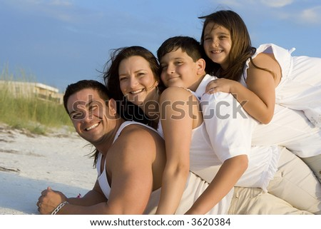 Happy family having good time on a beach.