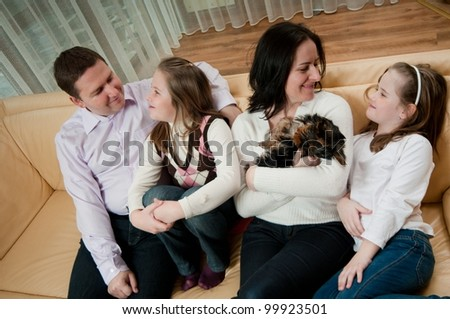 Happy family having great time together at home on sofa - stock photo
