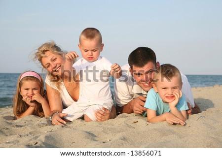 happy family having holiday at the beach - stock photo