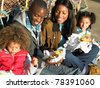 Happy family having picnic - stock photo