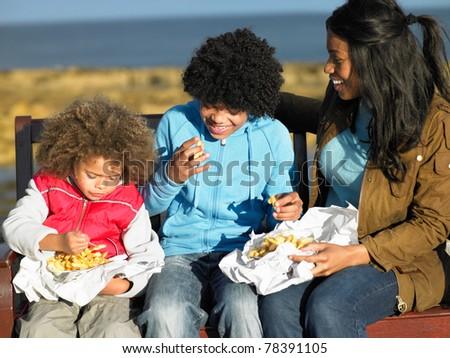 Happy family having picnic - stock photo