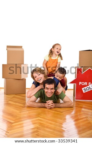 Happy family heap in their new home having fun on the floor - isolated - stock photo