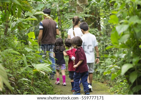 Happy Family Hiking on the forest