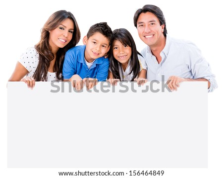 Happy family holding a placard  and smiling - isolated over white  - stock photo