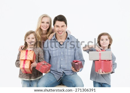 Happy family holding gifts