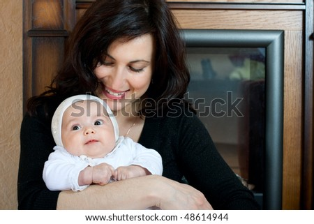 happy family home: mother and baby girl
