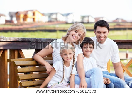 Happy family homes on the background - stock photo