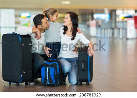 happy family hugging at airport - stock photo