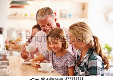 Happy family in a cafe - stock photo