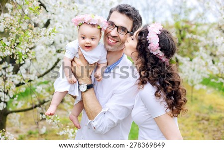 Happy family in a garden - stock photo