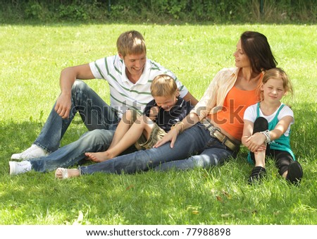 happy family in a park - stock photo