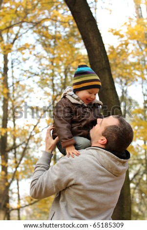 Happy family in autumn. - stock photo