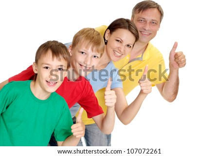 Happy family in bright T-shirts on a white background - stock photo