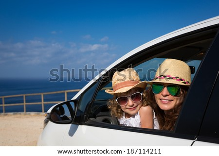 Happy family in car against sea and sky. Summer vacations - stock photo