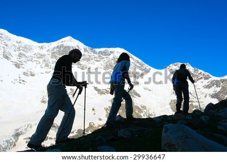 Happy family in Caucasus mountains - stock photo