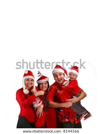 Happy family in Christmas costumes - stock photo