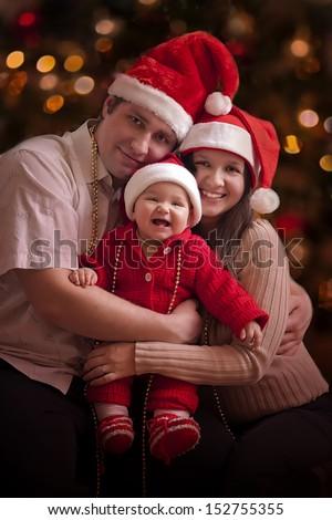 Happy family in christmas hats - stock photo