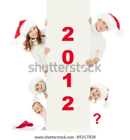 happy family in Christmas Santa's hats: 2 parents, 2 daughters, 1 son, and one empty space for new child.  2012 is encoded by picture. All red digits are easily removable. - stock photo