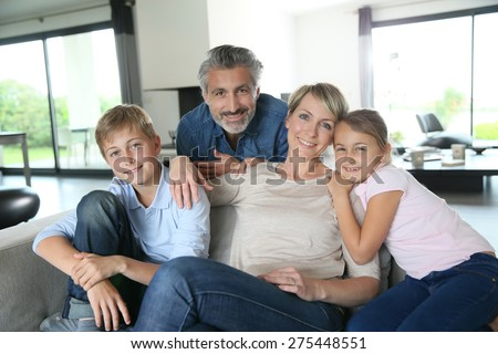 Happy family in contemporary house - stock photo