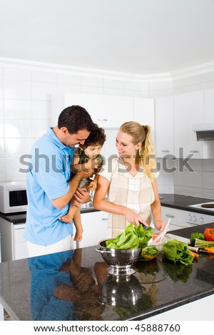 happy family in home kitchen cooking food