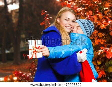 Happy family in in autumn park - stock photo