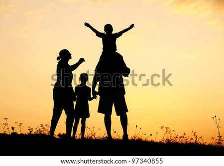 Happy family in nature at sunset - stock photo
