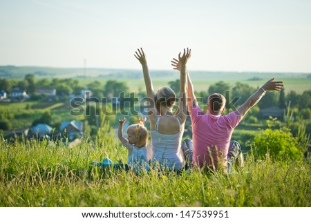 happy family in nature enjoy the freedom - stock photo
