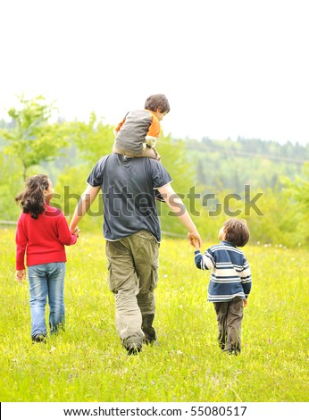 happy family in nature, father and children walking - stock photo