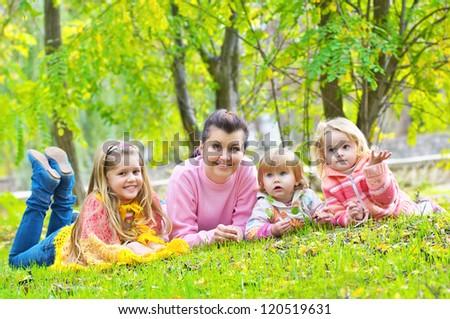 Happy family in park - stock photo