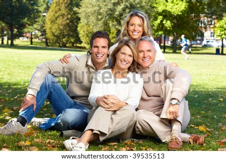 Happy family in park. Father, mother, son and daughter