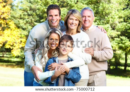 Happy family in park. Grandfather, grandmother, father, mother and son