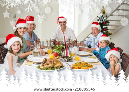 Happy family in Santa hats having Christmas meal against fir tree forest and snowflakes - stock photo