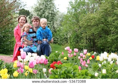 Happy family in spring park - stock photo