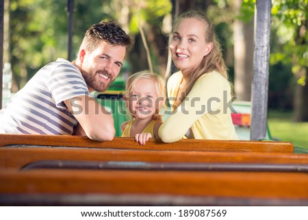 Happy family in the amusement park - stock photo