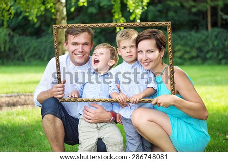 Happy family in the garden - stock photo