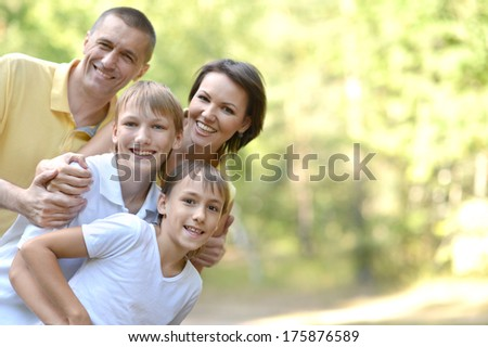 Happy family in the green summer park