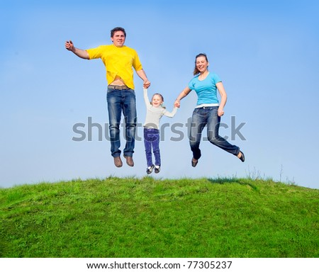 Happy family in the jump against the sky - stock photo