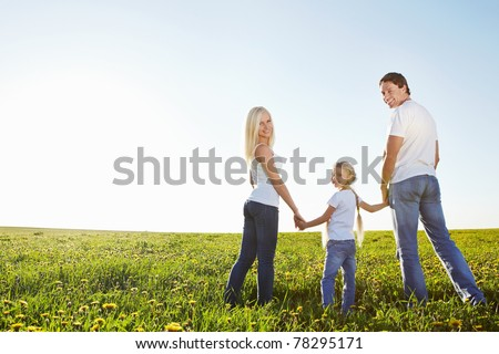 Happy family in the lush field