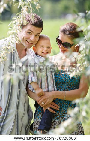 Happy family in the nature