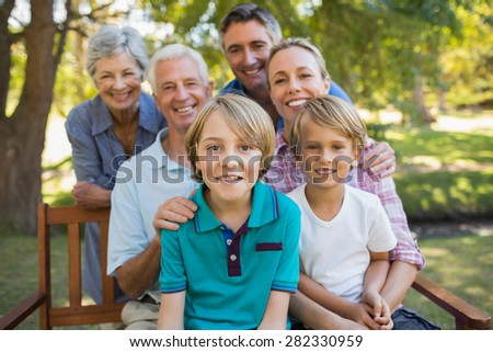 Happy family in the park on a sunny day