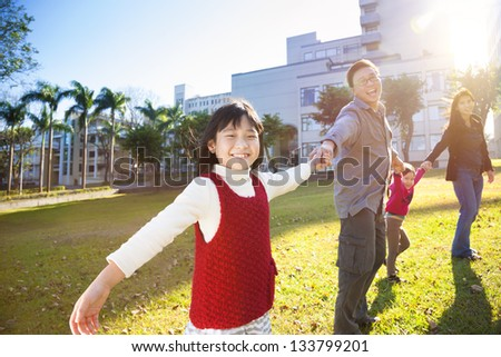 happy  family in the school with sunlight background - stock photo