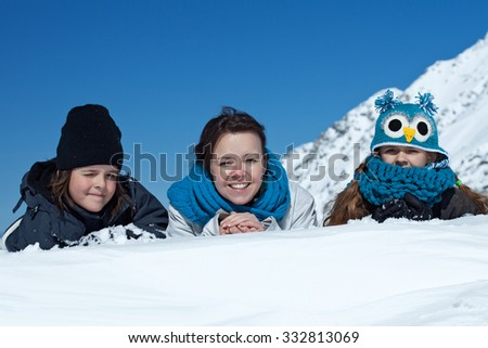 Happy family in the snow - enjoying the winter, portrait in the mountains - stock photo